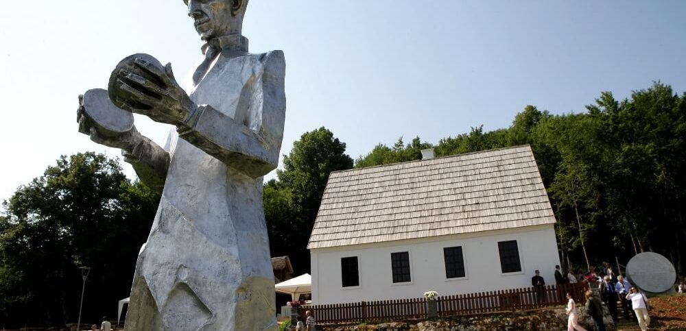 monument of Croatian Serb scientist Nikola Tesla stands in front of his renovated house in Smiljan, central Croatia