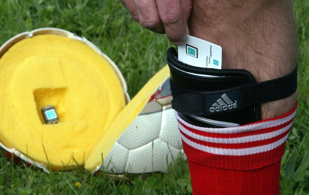 A football player tests a new high tech system for soccer that has a microchip built into