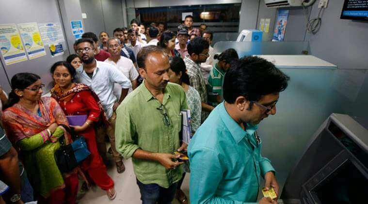 People waiting to withdraw money from ATM - Alvexo