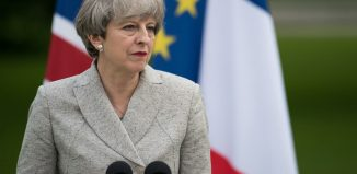 Theresa May sets quitting date