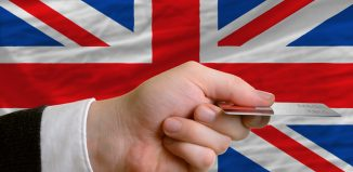 credit card in front of the british flag