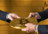Hands of three financial traders gripping bitcoin against a background of rising prices for the currency