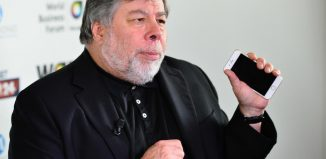 Steve Wozniak (Stephen Gary) co-founder Apple Computer during a WOBI conference holding an iPHONE (1)