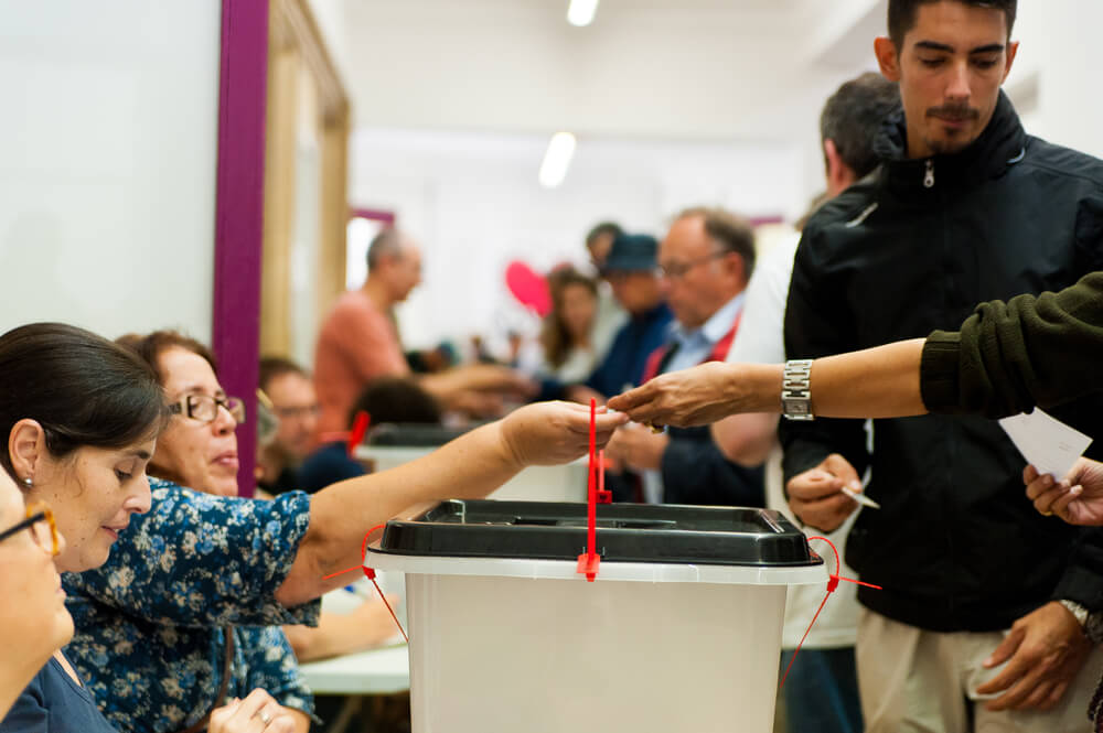 people voting during illegal referendum for catalan indepedence