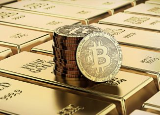 Bitcoin laying on stacked gold bars gold ingots bars