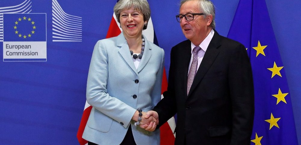 Britains Prime Minister Theresa May is welcomed by European Commission President Jean-Claude Junck