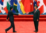 Chinese President Xi Jinping welcomes Japanese Prime Minister Shinzo Abe to the G20 Summit in Hangzhou