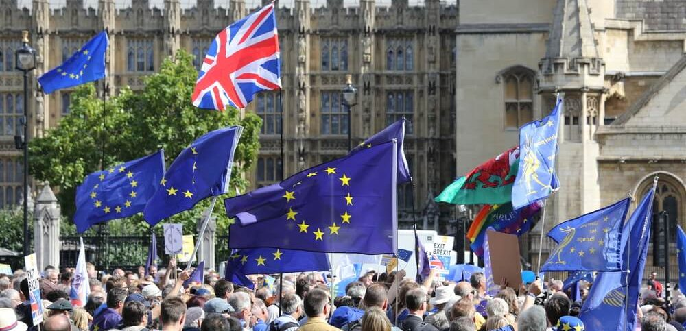 EU and Uk flags as a crowd gather for an anti-Brexit rally at the Houses of Parliament in the week when the EU withdrawal bill was introduced to parliament.
