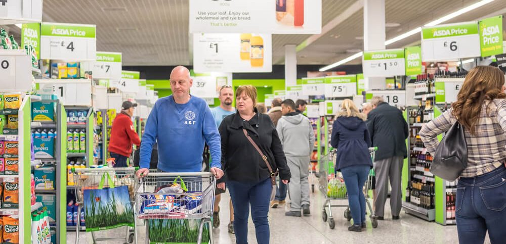 People shopping in Asda supermarket, one of the biggest chains of supermarkets in United Kingdom.