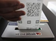 A bitcoin ATM prints out a receipt for a user at the Vape Lab cafe London