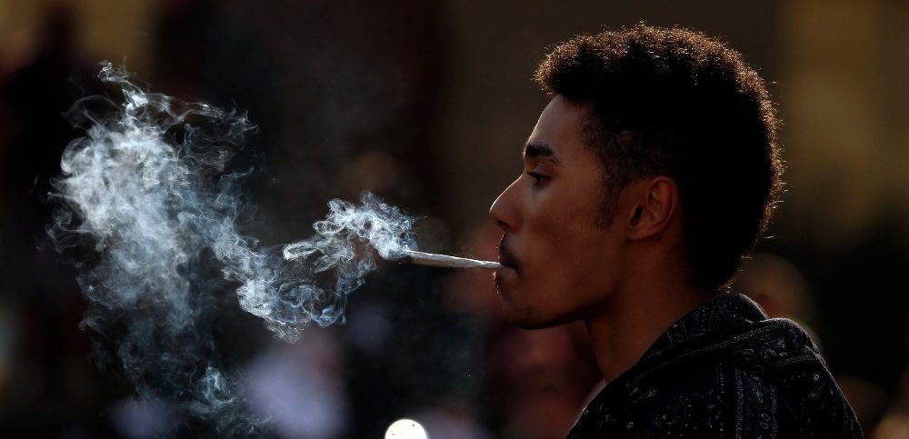 A man smokes cannabis at a pro-cannabis rally beside the Houses of Parliament in London (1)