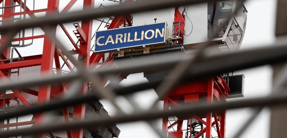 Carillion logos are seen on cranes at a building site in London