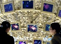 South Korean women view thin-film transistor liquid crystal displays (TFT-LCD) on display at the headquarters of Samsung group in Seoul