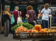 people shopping at Brockley Market, a local farmer's market held every Saturday in Lewisham