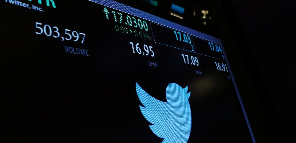 A screen displays the stock price of Twitter above the floor of the New York Stock Exchange (NYSE) shortly after the opening bell in New York
