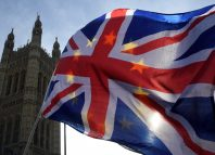 Anti-Brexit demonstrators wave EU and Union flags outside the Houses of Parliament in London