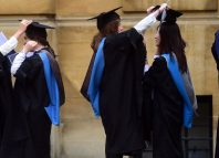 Graduates gather outside the Sheldonian Theatre after a graduation ceremony at Oxford University in Oxford