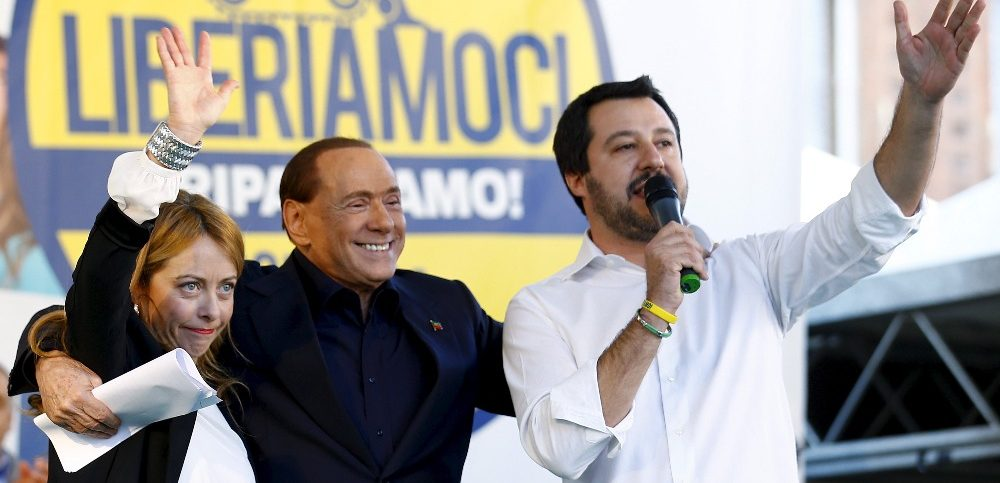 Silvio Berlusconi stands with Matteo Salvini during a rally in Bologna 2015