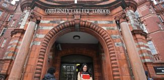 Students and visitors are seen walking around the main campus buildings of University College London (UCL) in London Britain