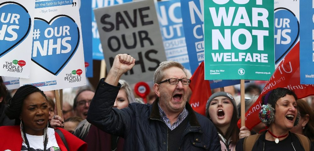 Unite union leader Len McCluskey takes part in a demonstration to demand more funding for Britain's National Health Service (NHS), in London