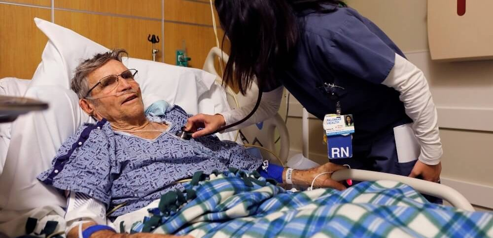 a patient is treated for the flu by float nurse Nellie Reyes in the emergency room at Palomar Medical Center in Escondido California