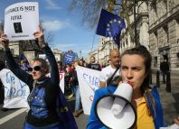 angry demonstrators march on Westminster in protest against Brexit and the Brexit process