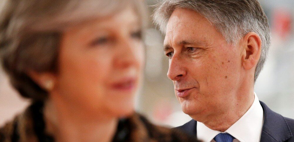 Britains Prime Minister Theresa May and Chancellor of the Exchequer Philip Hammond visit an engineering training facility in the West Midlands