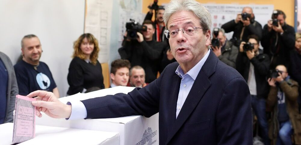 Italian Prime Minister Paolo Gentiloni casts his vote at a polling station in Rome