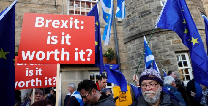 Protester hold placards Saltires and EU flags during a demonstration to demand a vote on the Brexit deal between Britain and the European Union in Edinburgh Scotland
