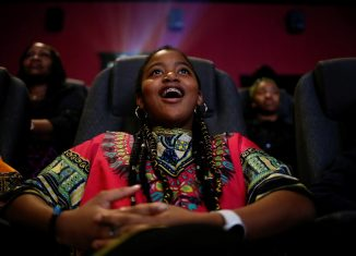 Ron Clark Academy 6th grader De Ja Little 12 joins classmates in watching the film Black Panther at Atlantic Station theaters in Atlanta
