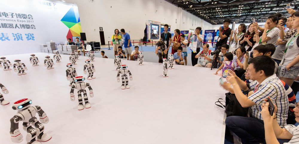 Visitors enjoy a Robots performance during the 3E Beijing International Consumer Electronics Expo 2017