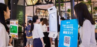 A customer tries Alipays facial recognition payment solution Smile to Pay at KFCs new KPRO restaurant in Hangzhou Zhejiang province