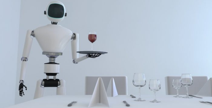A service robot serving wine in a dining room table