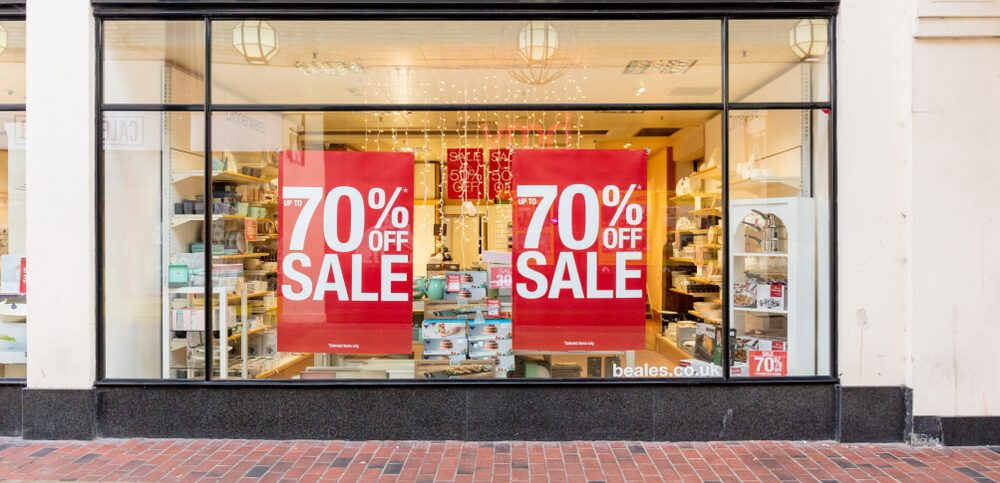 Beales Department Store Window Display With Two Large Red Sale Signs on Window