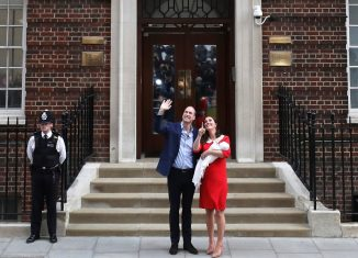 Britains Catherine the Duchess of Cambridge and Prince William leave the Lindo Wing of St Marys Hospital with their new baby boy in London