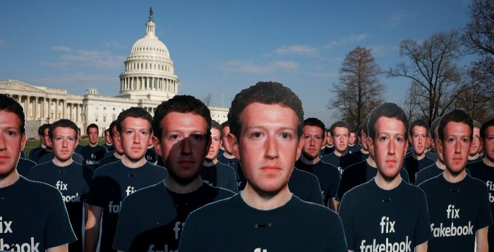 Dozens of cardboard cutouts of Facebook CEO Mark Zuckerberg are seen during an Avaazorg protest outside the US Capitol in Washington