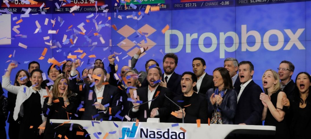Dropbox Inc co-founders celebrate on the Nasdaq Stock Market as Dropbox (DBX) is listed for the companys IPO in New York