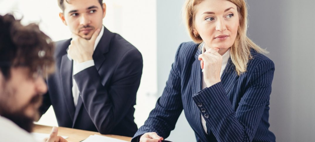 Man sitting nexy to a female colleague at work (1)