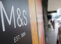 Clothes are displayed at a Marks and Spencer store in central London, Britain