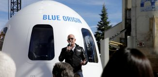 Amazon and Blue Origin founder Jeff Bezos addresses the media about the New Shepard rocket booster and Crew Capsule mockup at the 33rd Space Symposium in Colorado Springs April 2017