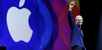 Apple CEO Tim Cook waves as he arrives on stage to deliver his keynote address at the Worldwide Developers Conference in San Francisco