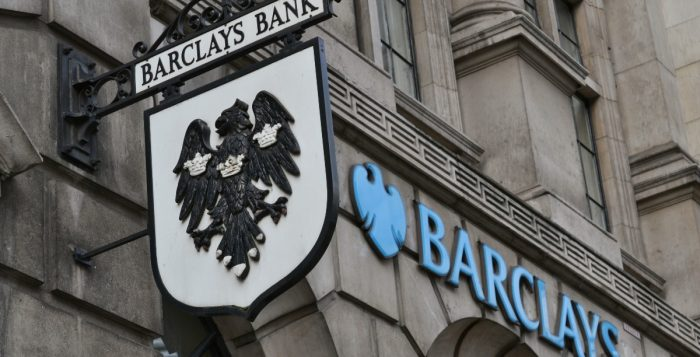 Barclays bank old hanging street sign and modern logo next to it