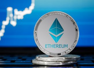ETHEREUM (ETH) cryptocurrency silver ethereum coin on the background of the chart