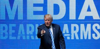 President Donald Trump gestures after speaking at a National Rifle Association (NRA) convention in Dallas