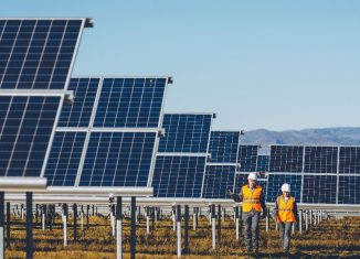 Solar power station with workers near by