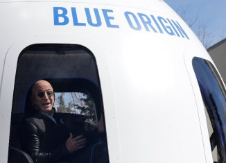 Amazon and Blue Origin founder Jeff Bezos addresses the media about the New Shepard rocket booster and Crew Capsule mockup at the 33rd Space Symposium in Colorado Springs.