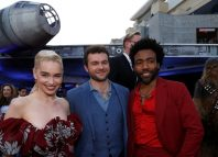 Cast members Clarke Ehrenreich and Glover pose at the premiere for the movie Solo A Star Wars Story in Los Angeles