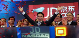 Liu CEO and founder of JDcom smiles before ringing the opening bell at the NASDAQ Market Site building in New York