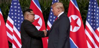 U.S. President Donald Trump shakes hands with North Korean leader Kim Jong Un at the Capella Hotel on Sentosa island in Singapore.