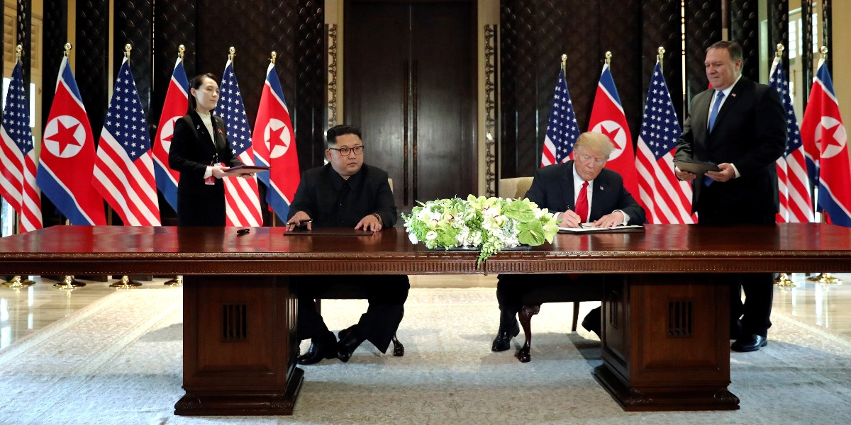 U.S. President Trump and North Korea's Kim hold a signing ceremony at the conclusion of their summit in Singapore.
